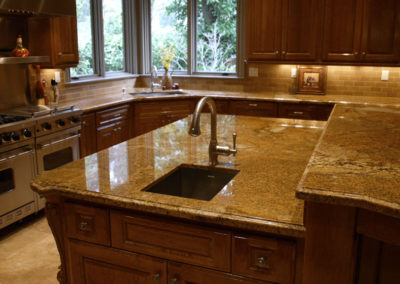 Granite makes the kitchen in this timeless beauty