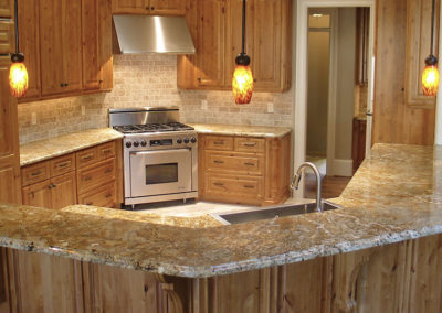 Ogee Edge Detail and a Travertine Backsplash